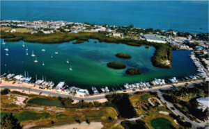 Aerial picture looking down over the bay with Sombrero Marina, boat slips, and dockside bar and grill